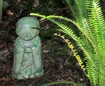 Buddha Statue with fern fronds