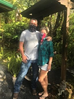 Big Island couple standing outside with masks