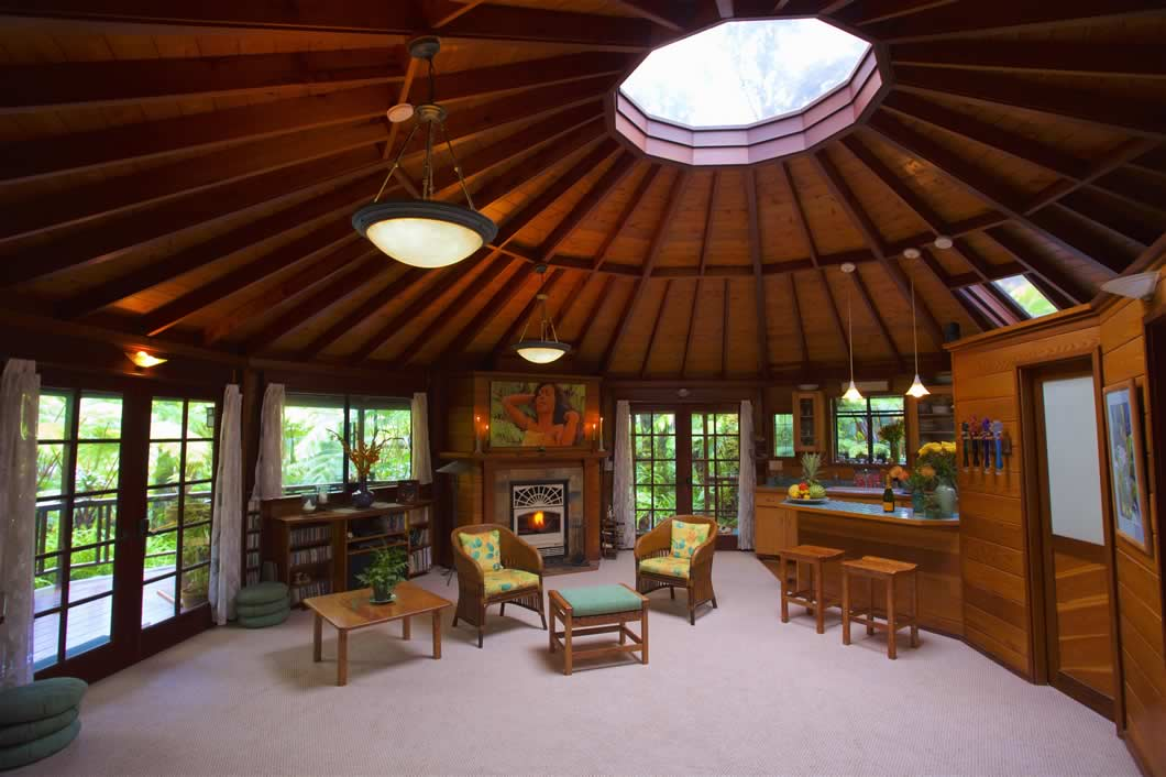 Skylight House Living Room with coffee table & chairs with fireplace and kitchen